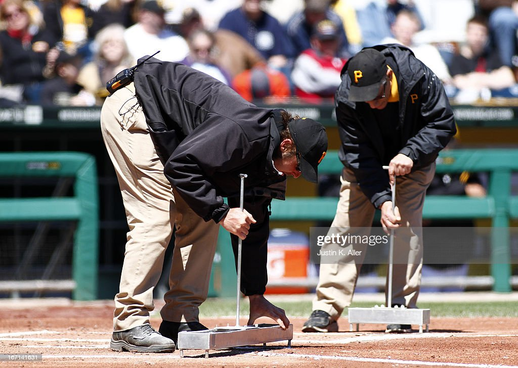 The PNC Park grounds crew re-lines the batters box in the second inning during the game between the Pittsburgh Pirates and the Atlanta Braves on April 21, 2013 at PNC Park in Pittsburgh, Pennsylvania.