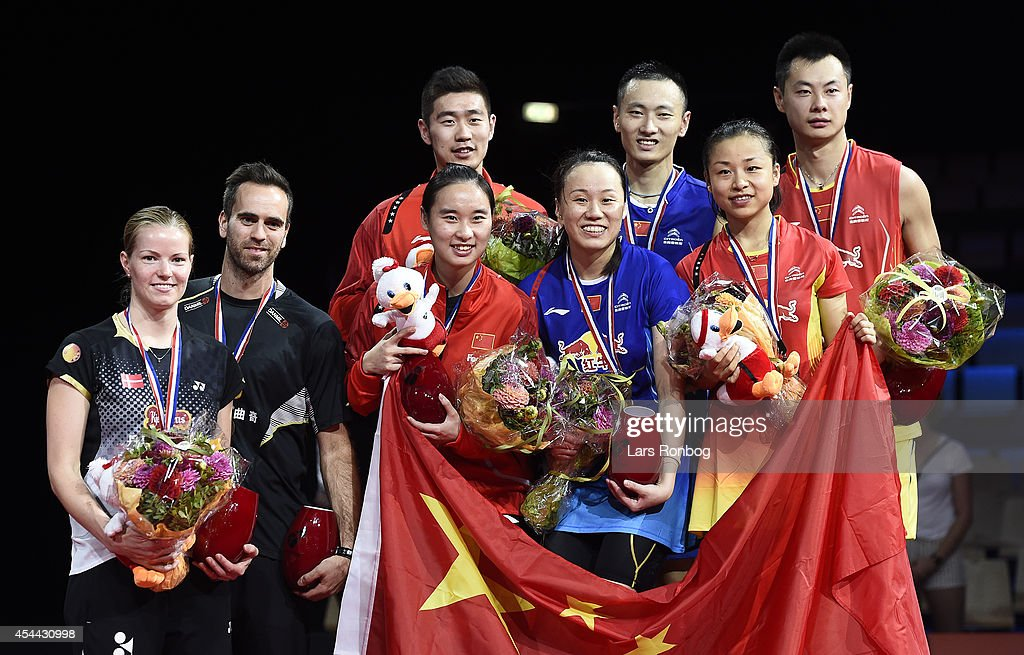 The podium in the mixed doubles - (L to R) <a gi-track='captionPersonalityLinkClicked' href=/galleries/search?phrase=Christinna+Pedersen&family=editorial&specificpeople=5933396 ng-click='$event.stopPropagation()'>Christinna Pedersen</a> and <a gi-track='captionPersonalityLinkClicked' href=/galleries/search?phrase=Joachim+Fischer+Nielsen&family=editorial&specificpeople=5851511 ng-click='$event.stopPropagation()'>Joachim Fischer Nielsen</a> of Denmark (Bronze) - Cheng Liu and Yixin Bao of China (Bronze) - Nan Zhang and Yunlei Zhao of China (Gold) - Chen Xu and Jin Ma of China (Slver) after the finals during the Li-Ning BWF World Badminton Championships at Ballerup Super Arena on August 31, 2014 in Copenhagen, Denmark.