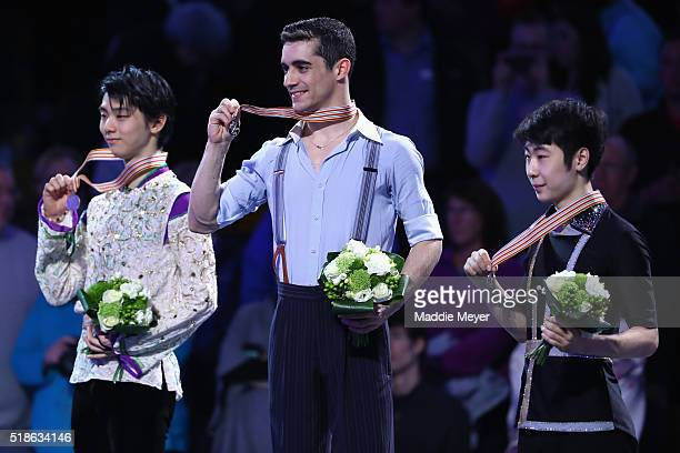 The podium is filled with from left silver medalist Yuzuru Hanyu of Japan gold medalist Javier Fernandez of Spain and bronze medalist Boyang Jin of...