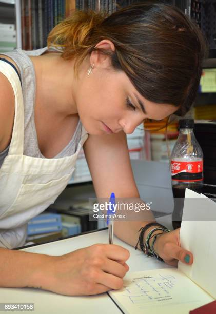 The poet Elvira Sastre signs a book during the Book Fair 2017 at El Retiro Park on May 28 2017 in Madrid Spain