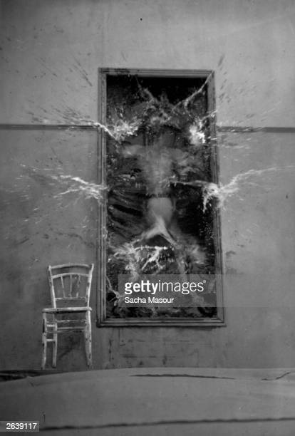 The poet falls through his mirror into a world of fantasy in a scene from the film by French surrealist Jean Cocteau 'Le Sang d'un Poete' or 'The...