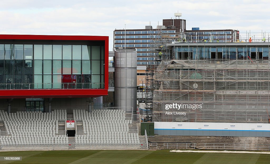 The Point is seen next to scaffolding as work is carried out on the old pavillion at Lancashire CCC during a pre-season photocall at Old Trafford on April 2, 2013 in Manchester, England.