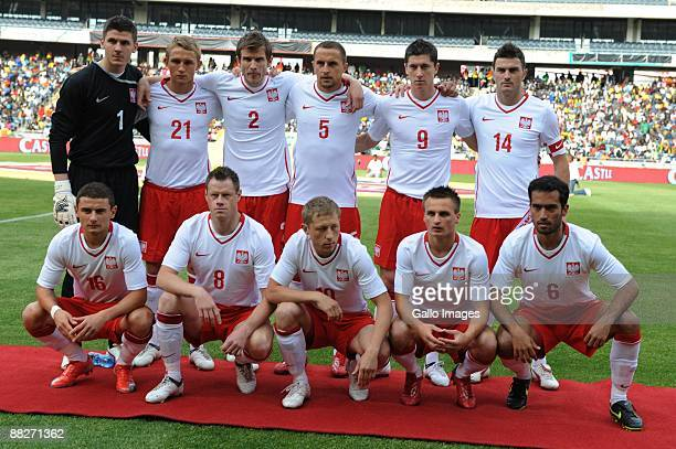 The Poland national football team pose for a group photo before the Confederation Cup match between South Africa and Poland at Orlando Stadium on...
