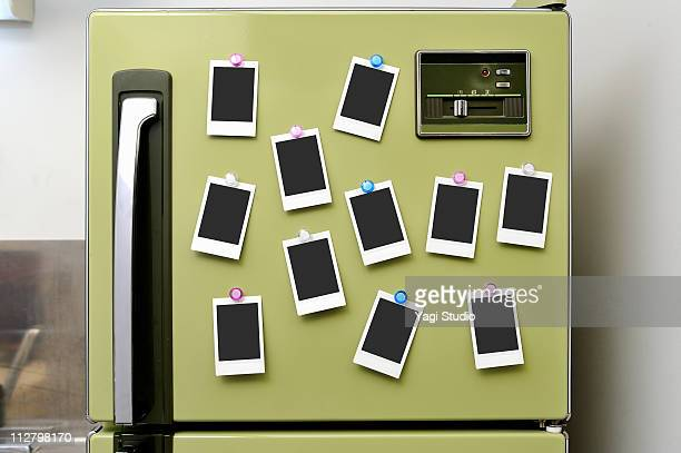 The polaroid fastened to the refrigerator with the