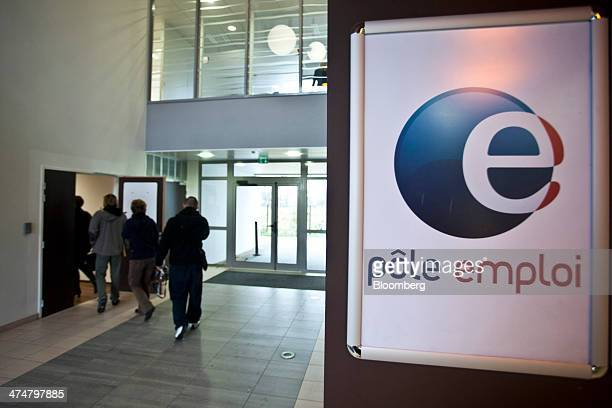 The Pole Emploi logo sits on display as visitors enter a branch of the French national employment agency in Montpellier France on Tuesday Feb 25 2014...