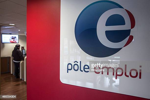 The Pole Emploi logo sits on display inside a French national employment agency in Montauban France on Tuesday March 3 2015 While jobless claims...