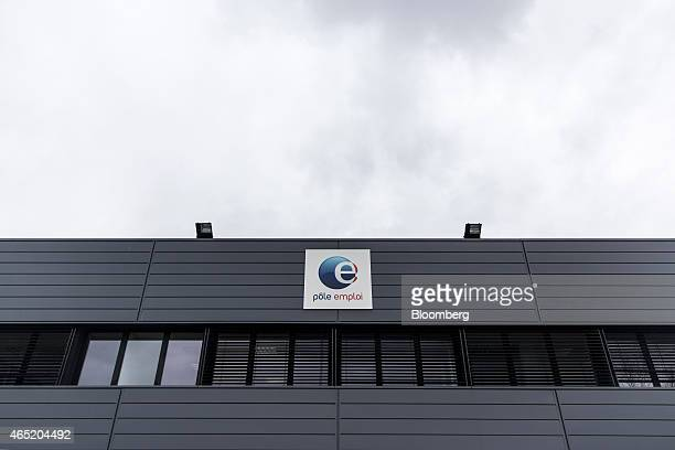 The Pole Emploi logo sits on display outside a French national employment agency in Montauban France on Tuesday March 3 2015 While jobless claims...