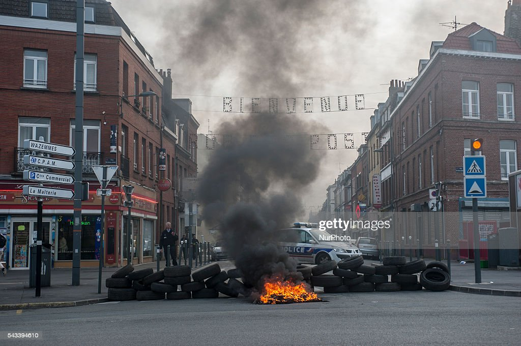 The police arrive in front of the barricades of the roundabout Posts blocked by trade unionists of the CGT in Lille, France on june 28, 2016. A new national day of action against labor law takes place throughout the la France. Economic blocking action was planned by the CGT in Lille this morning at 6:30 am.