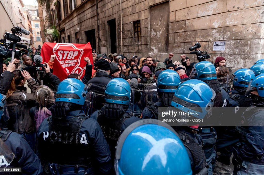 The police block the Movement for the right to housing and migrants during a demonstration against Lega Nord party leader Matteo Salvini on December 10, 2017 in Rome, Italy. The northern League called a demonstration against the 'Ius Soli' law as Italy's centre-left government was forced to delay a vote on a law granting citizenship to immigrants' children born in Italy.