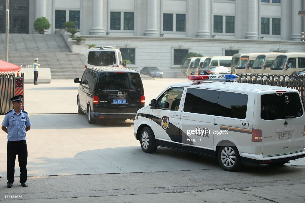 The police car (Right) transporting former Chinese politician Bo Xilai arrives at the Jinan Intermediate People's Court on August 22, 2013 in Jinan, China. Former Chinese politician Bo Xilai is standing trial on charges of bribery, corruption and abuse of power. Bo Xilai made global headlines last year when his wife Gu Kailai was charged and convicted of murdering British businessman Neil Heywood.