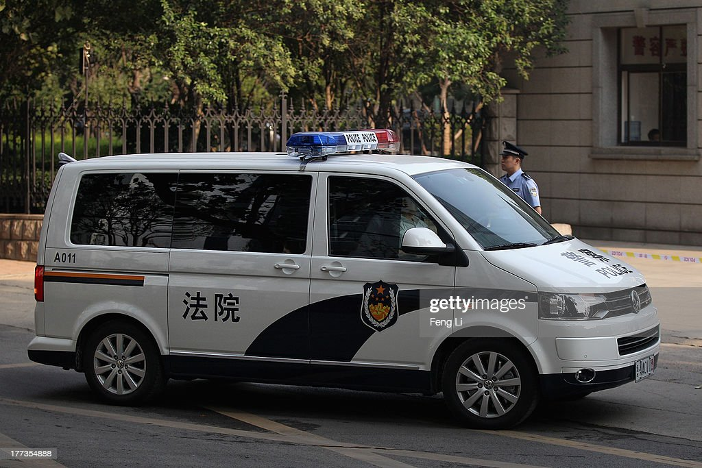 The police car transporting former Chinese politician Bo Xilai arrives at the Jinan Intermediate People's Court on August 23, 2013 in Jinan, China. Ousted Chinese politician Bo Xilai is standing trial on charges of bribery, corruption and abuse of power for a second straight day. Bo Xilai made global headlines last year when his wife Gu Kailai was charged and convicted of murdering British businessman Neil Heywood.