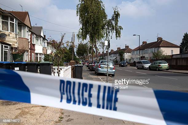 The police cordon near a property in Edmonton where a woman is thought to have been beheaded yesterday on September 5 2014 in London England The body...