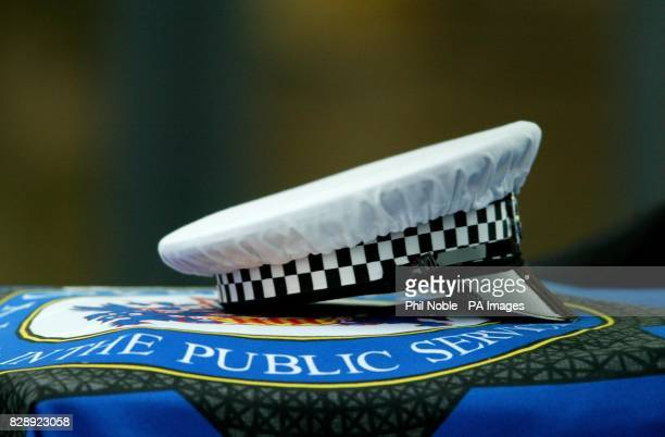 The police hat of murdered traffic policemen Ian Broadhurst placed on his coffin during the funeral service at Leeds Parish Church in Kirkgate Leeds...