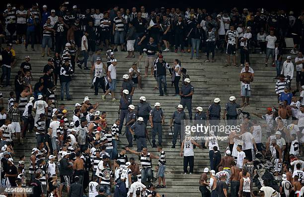 The police need to stop fights betwen fans of Corinthians during the match between Corinthians and Gremio for the Brazilian Series A 2014 at Arena...