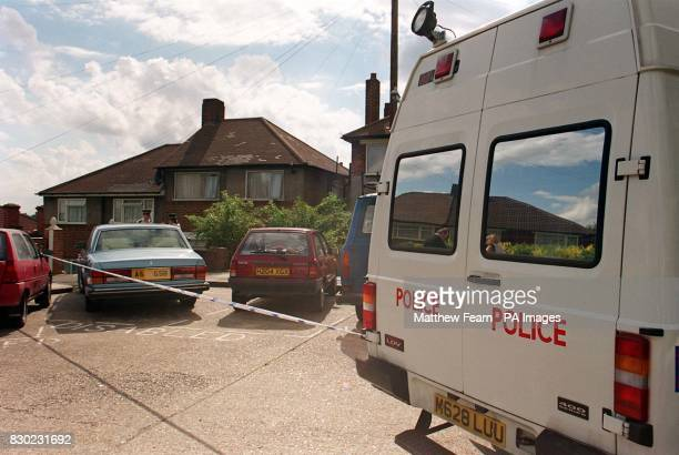 The police outside the house in London where a married couple where knifed to death A stunned relative found the bloodsoaked body of John Neale and...