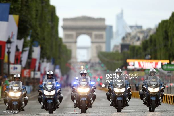 The police ride up the Champs Elysees during stage twenty one of Le Tour de France 2017 on July 23 2017 in Paris France
