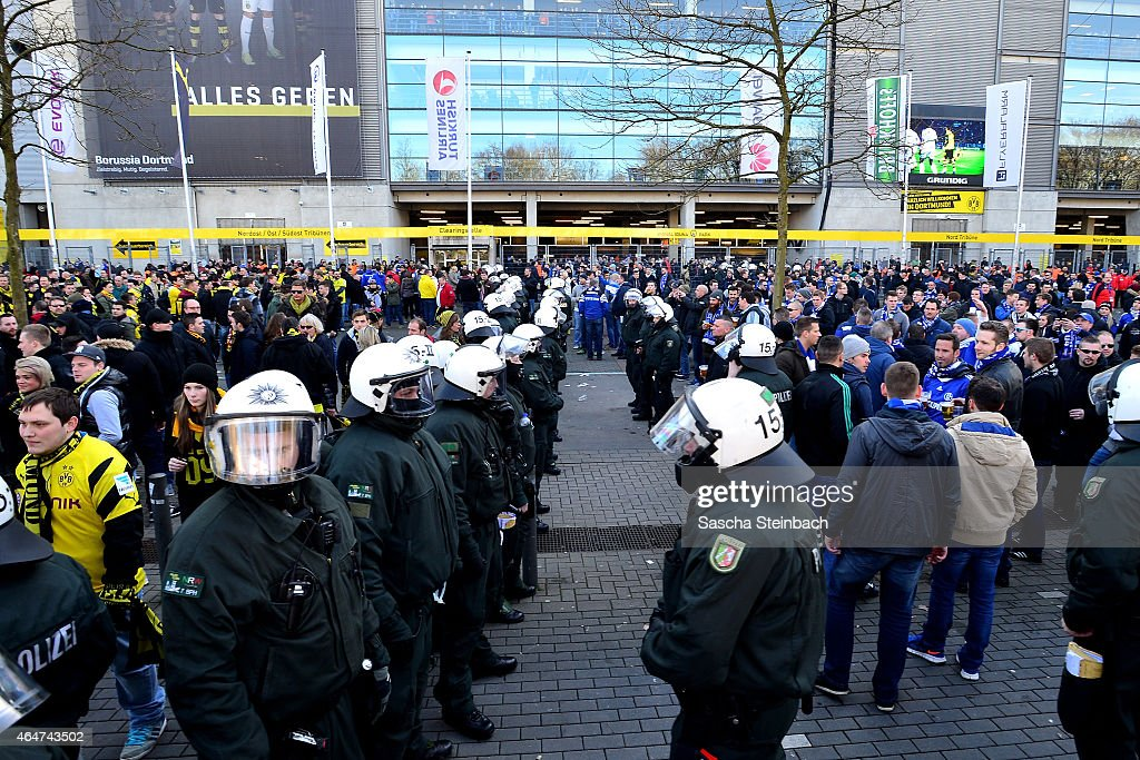 The police seperates supporters of Dortmund and Schalke prior to the Bundesliga match between Borussia Dortmund and FC Schalke 04 at Signal Iduna...