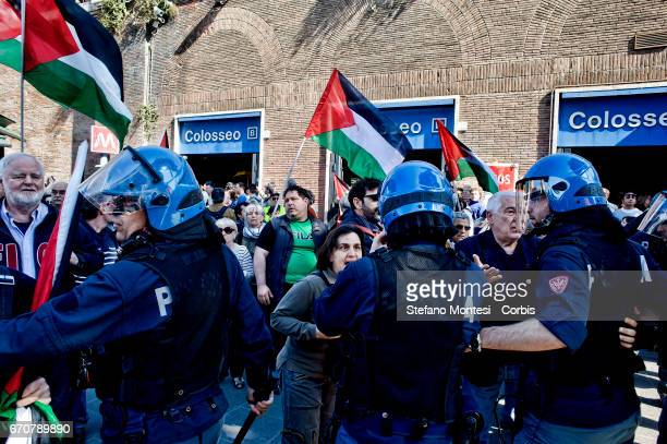 The police stop proPalestinian protesters during the march for the Liberation of Nazifascism organised by the National Association of Italian...
