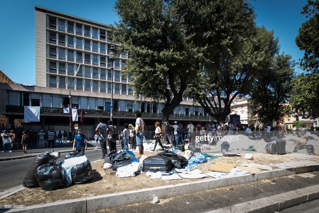The police try to remove refugees who camped in Piazza Indipendenza Gardens after their eviction from an occupied building in Piazza Indipendenza, on August 23, 2017 in Rome, Italy. From Saturday about 200 immigrants, all with regular residence permits and with the status of refugee and Prevenienti from Eritrea and Ethiopia, have camped in the street waiting to understand what will now be their destiny. About a hundred remain, including vulnerable families. The United Nations High Commissioner for Refugees (UNHCR) expresses 'particular concern about the lack of alternatives for most vacated persons'.