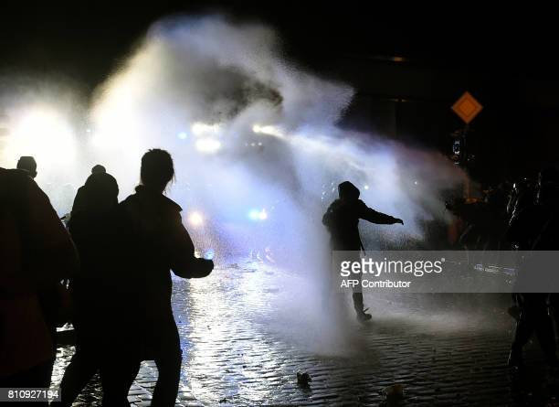 The police use water cannons during riots on July 8 2017 in Hamburg northern Germany after the leaders of the world's top economies gathered for a...