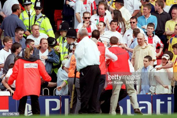 The police wade into the crowd to eject a Manchester United fan