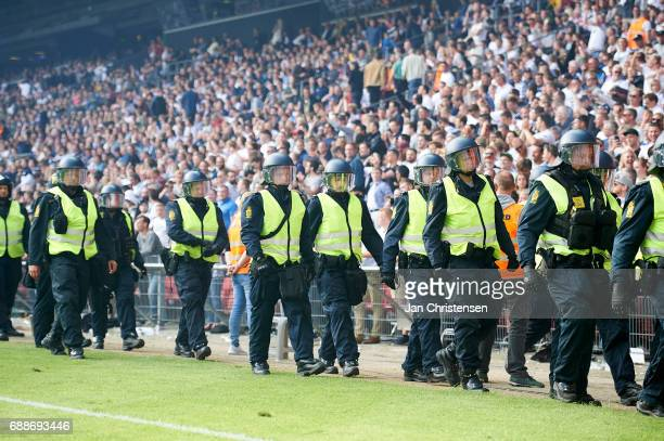 The police walk on to the pitch during the Danish Cup Final DBU Pokalen match between FC Copenhagen and Brondby IF at Telia Parken Stadium on May 25...