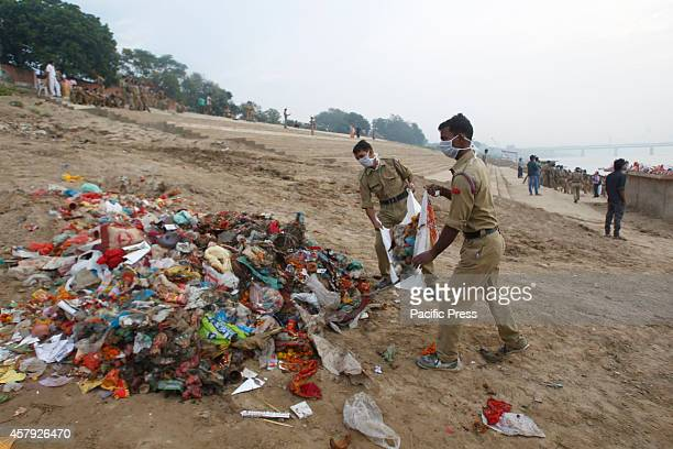 The policemen help in cleaning the garbage dumped at the river bank of Yamuna during the 'Swachh Bharat Abhiyan' or Clean India Mission early in the...