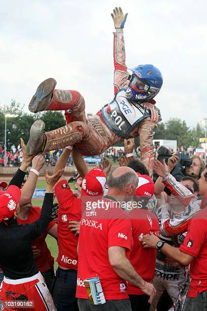 The Polish captain Tomasz Gollob is tossed in the air after Poland won the Speedway Team World Cup 2010 final on August 1 2010 in Vojens Denmark...