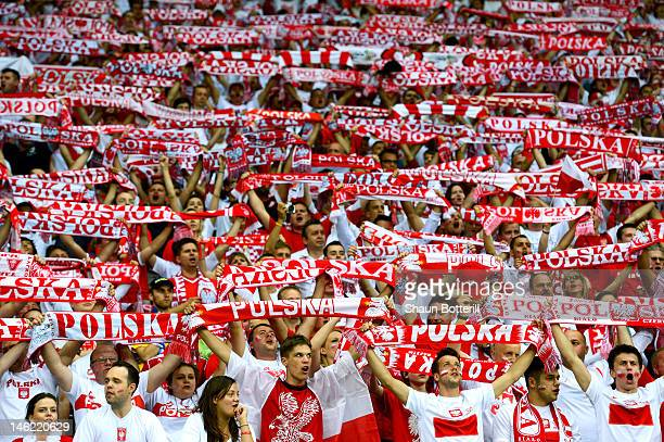 The Polish fans enjoy the atmosphere during the UEFA EURO 2012 group A match between Poland and Russia at The National Stadium on June 12 2012 in...