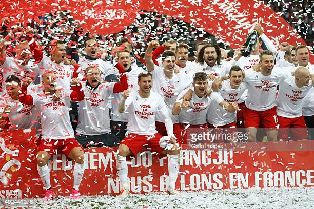 The Polish team celebtate their victory after the UEFA Euro 2016 Qualifying Round match between Poland and Ireland at the National Stadium on October...