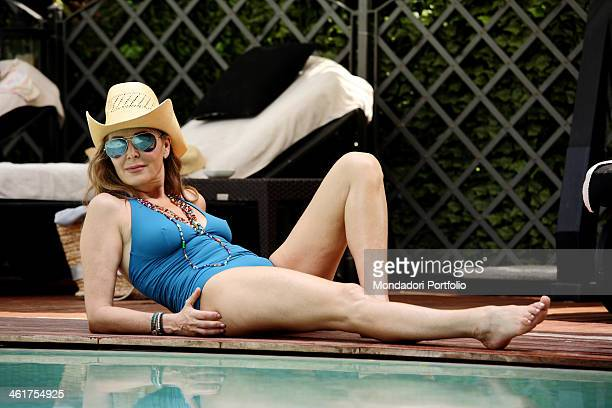 The politician Daniela Santanchè photographed while relaxing by the swimming pool of the Grand Hotel Imperiale Forte dei Marmi Italy 27th June 2010