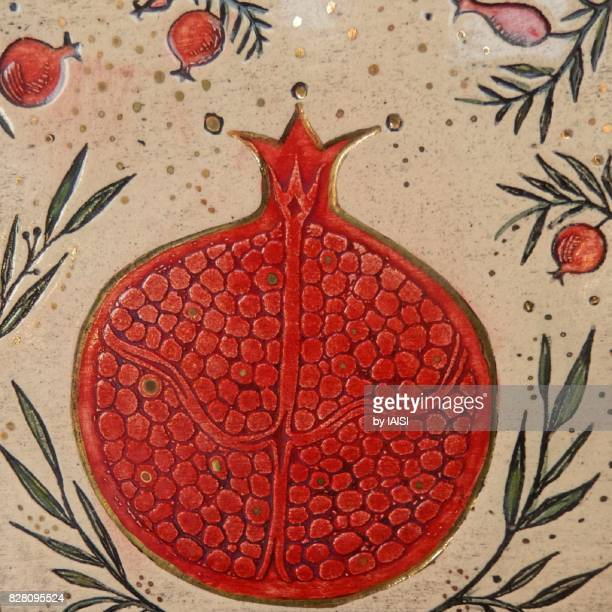 The pomegranate with its seeds, a symbol of abundance