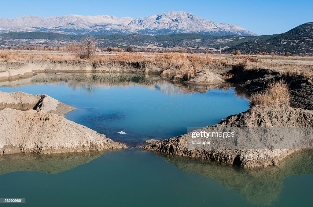 The pond formed in excavations - soil loss : Stock Photo
