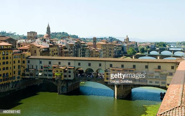 The Ponte Vecchio bridge spans the Arno river on August 15 in Florence Tuscany Italy Florence the capital city of Tuscany is famous for its history a...