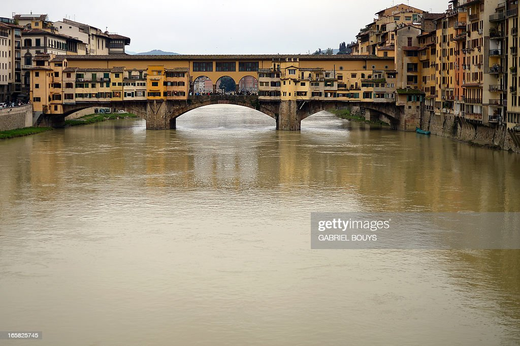 The Ponte Vecchio (Old Bridge) is pictured in Florence, on April 6, 2013. The bridge is a medieval stone closed-spandrel segmental arch bridge over the Arno River, noted for still having shops built along it, as was once common. Butchers initially occupied the shops; the present tenants are jewellers, art dealers and souvenir sellers.