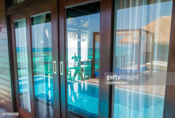 The Pool and Terrace of a Water Villa are reflecting at the Window of the LivingRoom at Coco Bodu Hiti NorthMaleAtoll on February 23 2017 in Male...