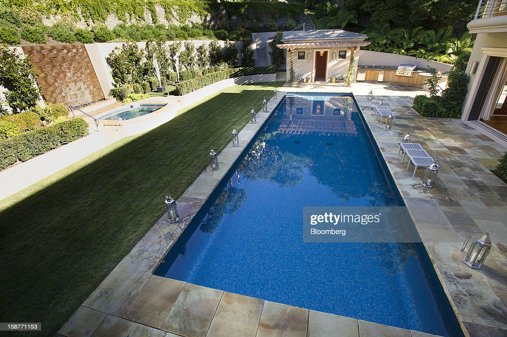 The pool area of a 15,000 square-foot custom built home lies in shadows on Belvedere Island in Marin County, California, U.S., on Wednesday, Dec. 19, 2012. The builder couldn't find a buyer for the brand-new waterfront mansion he listed in January for $45 million. He hopes one will turn up at a Dec. 30 auction, where the starting bid will be $25 million. Photographer: David Paul Morris/Bloomberg via Getty Images