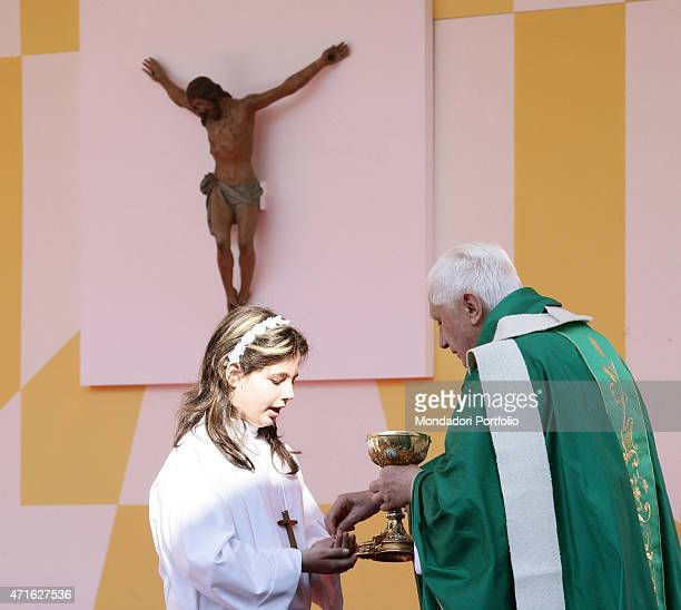 'The pope Benedict XVI giving Communion to a girl during his pastoral visit to the Suburbicarian Diocese of VelletriSegni Velletri Italy September...