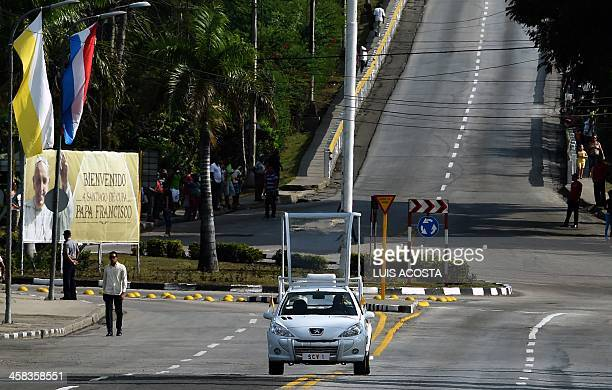 The popemobile is seen on the streets of Santiago de Cuba in eastern Cuba where Pope Francis will hold an encounter with families and bless the city...
