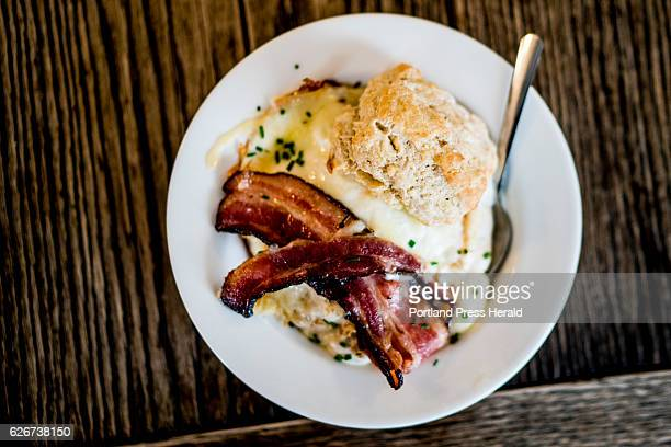 The 'Pops Cure' a staple at Biscuits Co in downtown Biddeford is photographed Friday November 25 2016 The dish features biscuits and gravy with two...