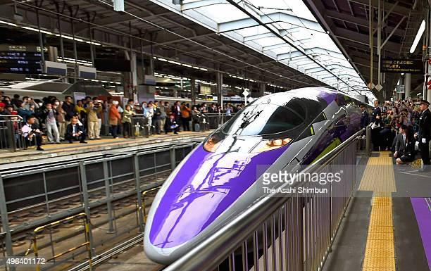 The popular animation series 'Neon Genesis Evangelion' themed Shinkansen bullet train '500 Type Eva' departs at Shin Osaka Station on November 7 2015...