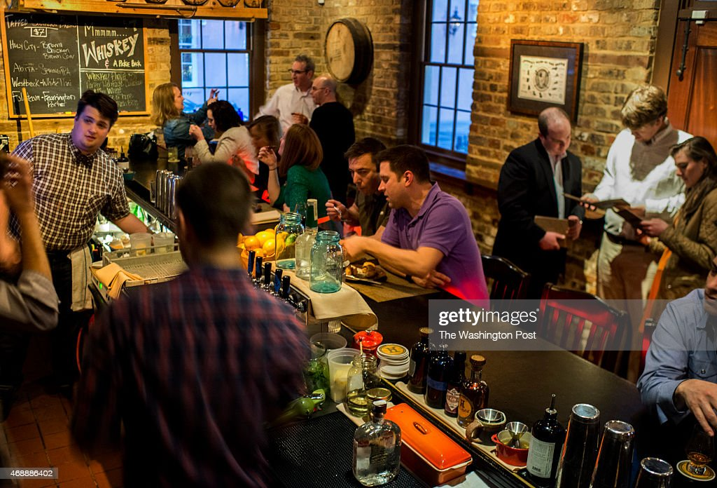 The popular Husk bar is directly across the alley from the Husk in Charleston South Carolina on Friday March 13 2015