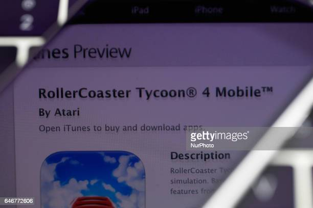 The popular RollerCoaster Tycoon game is seen in the iTunes App Store on 1 March 2017 in Bydgoszcz Poland Recenlty the newer version the Touch...