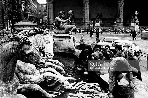 The population getting in a supply of water from the Fountain of Neptune in consequence of the flood of the Arno River Florence November 1966