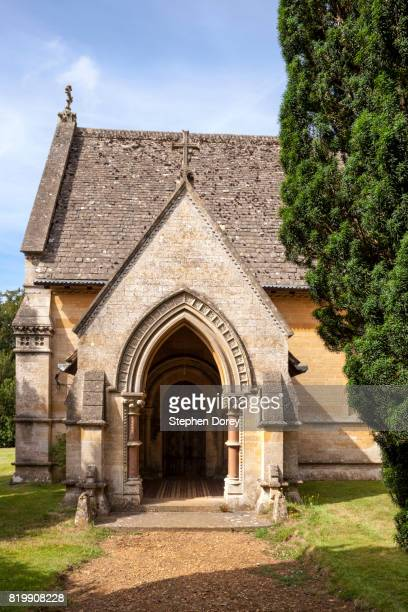 The porch of St Peter's church in the Cotswold village of Daylesford, Gloucestershire UK - The tomb of Warren Hastings (died 1818) is outside at the end of the chancel.