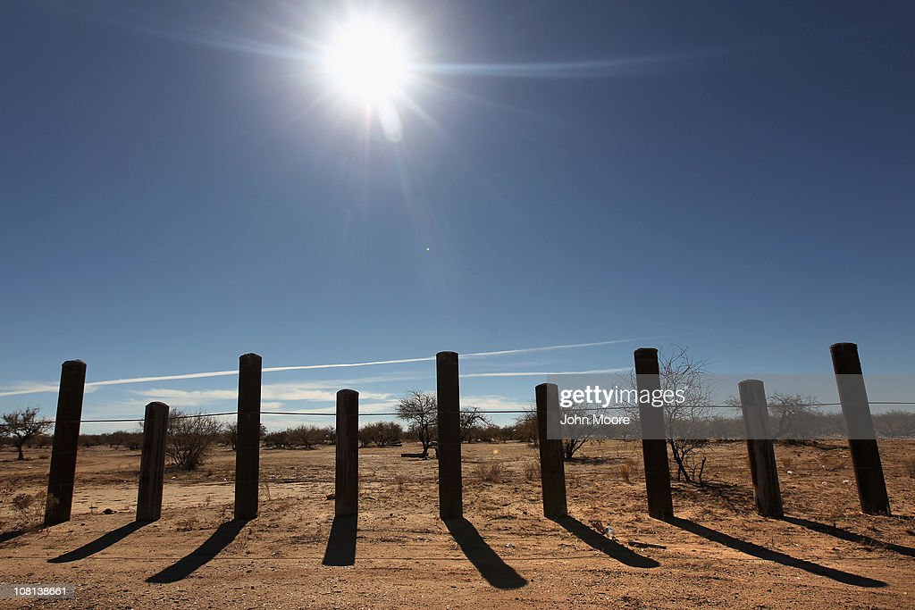The porous US Mexico border fence stretches through the Sonoran Desert on January 18 2011 in the Tohono O'odham Nation Arizona The Native American...