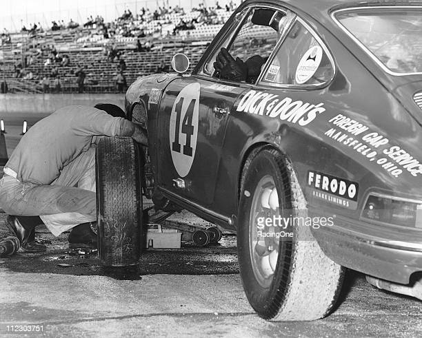 The Porsche 911 of Bert Everett / Alan Johnson / E Linley Coleman undergoes a brake pad change during the running of the 24 Hours of Daytona at...