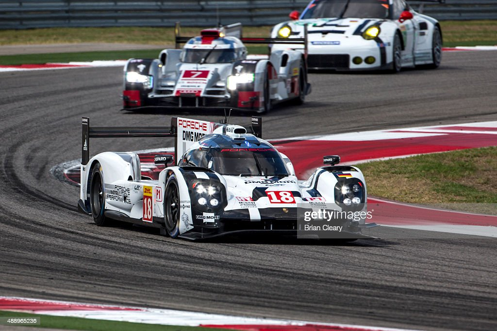 The #18 Porsche 919 Hybrid of <a gi-track='captionPersonalityLinkClicked' href=/galleries/search?phrase=Romain+Dumas&family=editorial&specificpeople=805197 ng-click='$event.stopPropagation()'>Romain Dumas</a>, <a gi-track='captionPersonalityLinkClicked' href=/galleries/search?phrase=Neel+Jani&family=editorial&specificpeople=541892 ng-click='$event.stopPropagation()'>Neel Jani</a>, and <a gi-track='captionPersonalityLinkClicked' href=/galleries/search?phrase=Marc+Lieb&family=editorial&specificpeople=3199675 ng-click='$event.stopPropagation()'>Marc Lieb</a> races through a turn during practice for the FIA World Endurance Championship race at Circuit of The Americas on September 18, 2015 in Austin, Texas.