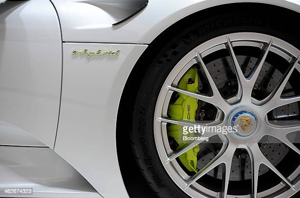 The Porsche AG logo is seen on the hubcap of a 918 Spyder Ehybrid vehicle displayed during the 2014 North American International Auto Show in Detroit...