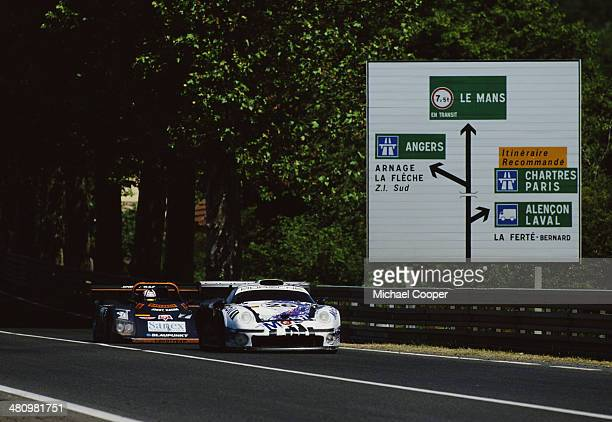 The Porsche AG Porsche 911 GT1 driven by Yannick Dalmas Scott Goodyear and Karl Wendlinger is followed along Tertre Rouge by the Joest Racing TWR...